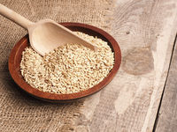 Peeled oats in a wooden bowl