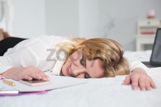 business woman tired and sleeping in bed