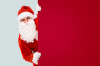 Santa Claus with colorful advertisement board