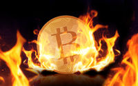 gold bitcoin on fire over black background