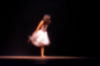 Young dancer with blurred soft motion