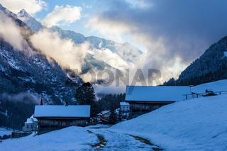 Snowy farm houses at the blue hour