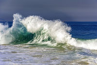 Big blue wave breaking on Ipanema beach