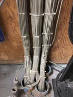 Hundreds of Cat 5 Cables Run into a Floor Chase