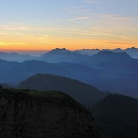 Early morning in the Swiss Alps. Mountain ranges at sunrise, View from Mount Niederhorn. Switzerland.