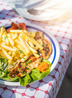 Grilled chicken breast and chips meal