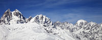 Mount Ushba in winter at wind sunny day