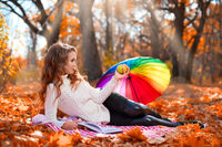 Young girl in autumn forest