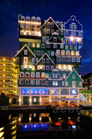 Inntel Hotel in Zaandam illuminated at night, Netherlands
