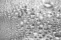 Water Drops On Grey Background