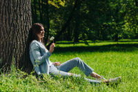Woman with dandelion in park