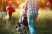 Man pushes woman in wheelchair to run after kids