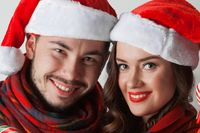 Christmas couple in Santa hats