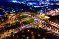 Night Aerial view of a freeway intersection traffic trails in night Moscow