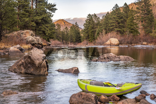 inflatable whitewater kayak on a mountain river