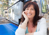 Attractive Middle Aged Woman Outdoor Portrait In Front of Class A RV