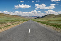 Empty asphalt road in Mongolia between mongolian towns Tsagaannuur and Bayan-Olgii