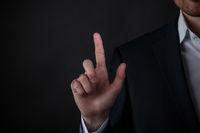 Businessman hand touching virtual screen