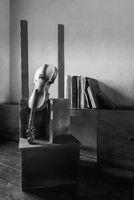 Black and white still life of broken old broken violin and vintage grunge books