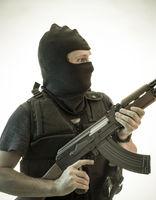 Crime, man armed with shotgun and bulletproof vest