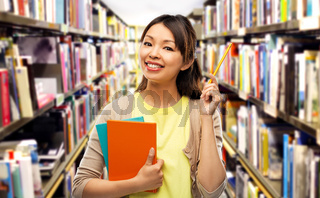 asian student woman with books and pencil
