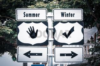 Street Sign to Winter versus Summer