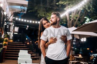 Young, beautiful couple posing at the camera