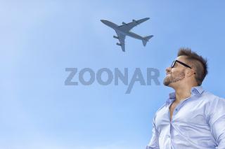 bearded man blue sky airplane
