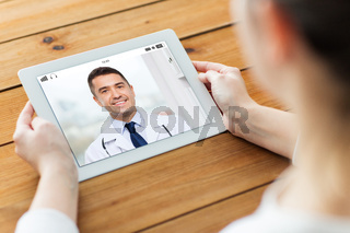 patient having video chat with doctor on tablet pc