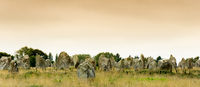 panorama view of the standing stone alignments of Carnac in Brittany at sunrise
