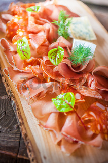 Rustic plate with sausage and ham