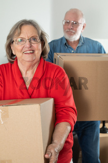 Senior Adult Couple Carrying Moving Boxes