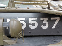 white numbers on the hood of a vintage American world war 2 vehicle with white letters and headlamp detail