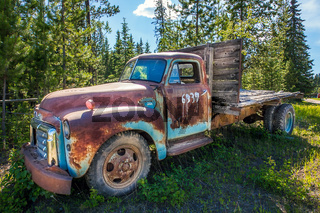 Fort Fraser, British Columbia, Canada. June 17, 2018. Old rusted car in the forest