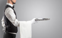 Waiter serving with white gloves and steel tray