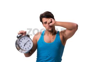 Man waking up with alarm clock isolated on white