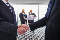 Engineer handshake at meeting