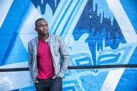 Hot buff black man posing outside in city