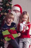 Children on santa claus knees