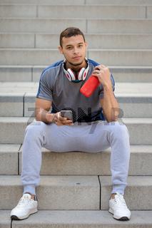 Smartphone young latin man runner jogger sport sports portrait format