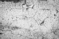 Old cracked paint on the concrete wall. Peeling paint on wall texture. Pattern of rustic blue grunge material