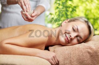 woman having salt massage in spa