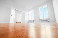 empty room after renovation - renovated apartment with wooden floor -