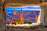 Verona historic skyline evening view through stone window