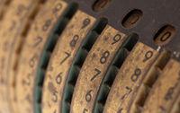 Vintage manual adding machine isolated