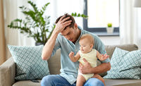 despaired father with little baby daughter at home