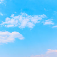 Pale blue sky with white clouds