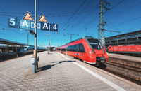 High speed red train on the railway station