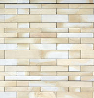 full frame image of a wall made of large flat blocks of textured yellow light brown york stone in different sized rows
