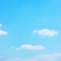 Cyan blue sky with white clouds